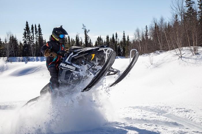 skiis up snowmobiling