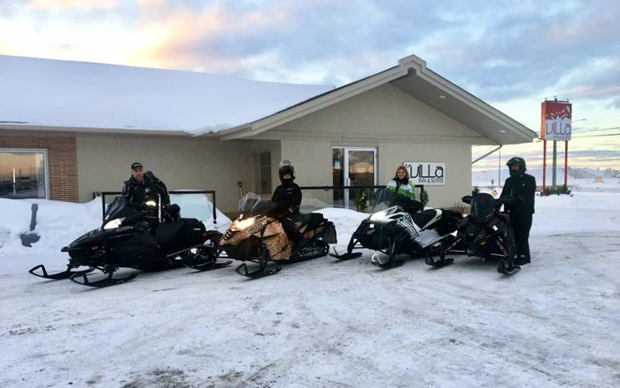 Snowmobiles out front of Villa Inn and Suites Hearst Ontario